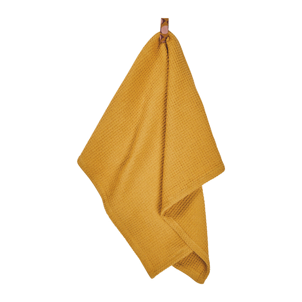 Soft and absorbent textural waffle tea towel in bright Dandelion hue with geometric ribbon loop.