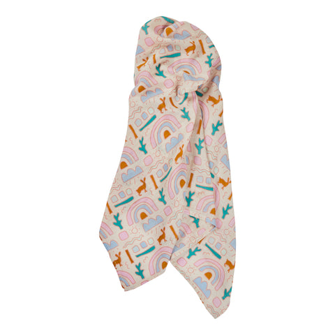 Keddie muslin wrap with child-like illustrations of snakes, cacti and rainbow clusters hand printed on muslin cotton.