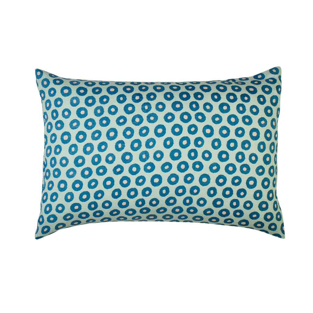 Standard light blue pillowcase with blue round evil eye circle motifs