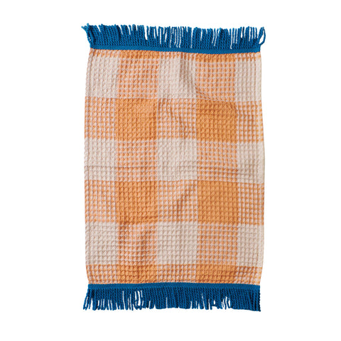 Woven hand towel made from absorbent textural waffle in our seasonal check pattern and finished with azure hand spun tassel trim.