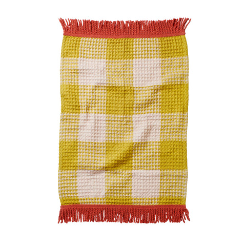 Woven hand towel made from absorbent textural waffle in our seasonal check pattern and finished with punch hand spun tassel trim.