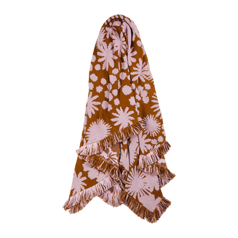 Mateo knit blanket with earthy tones of tan and taffy in a large feature floral with clusters of desert flora finished with fringed hem.