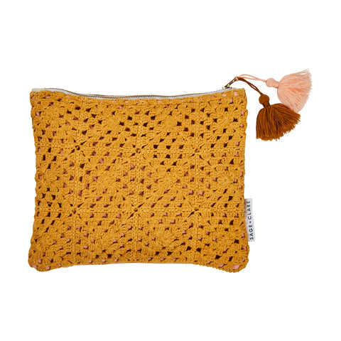 Palm Crochet Clutch. Handcrafted Crochet cloth in dandelion and terracotta. Hand printed geometric reverse.