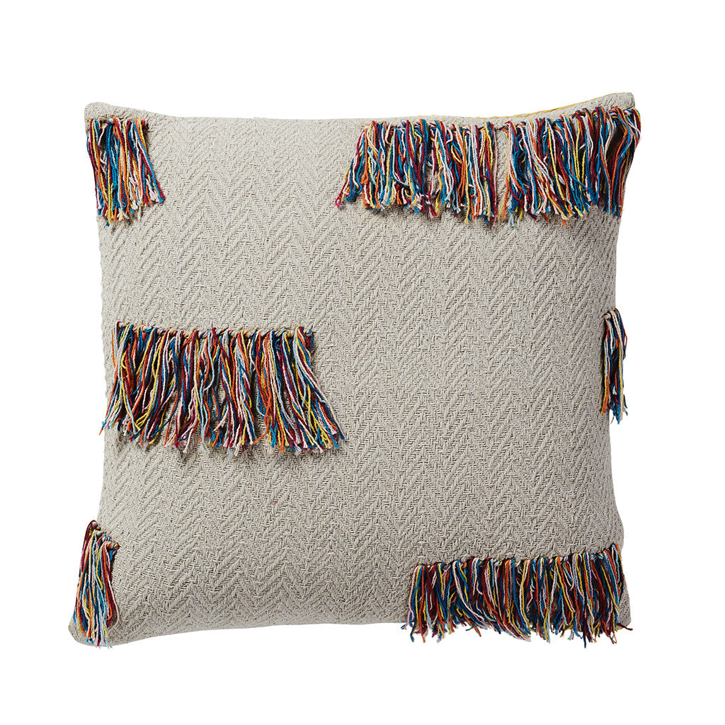 Playful multicolour fringing in our signature seasonal colours defines this textural woven chevron cushion