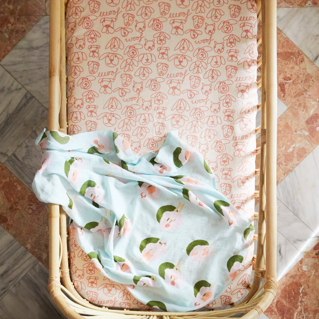 soft cotton muslin baby wrap with hand printed design, pale blue pattern