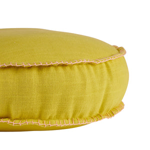 lemon yellow rylie round cushion with parchment blanket stitch detail