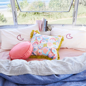 bright coral punch rylie round cushion with parchment blanket stitch