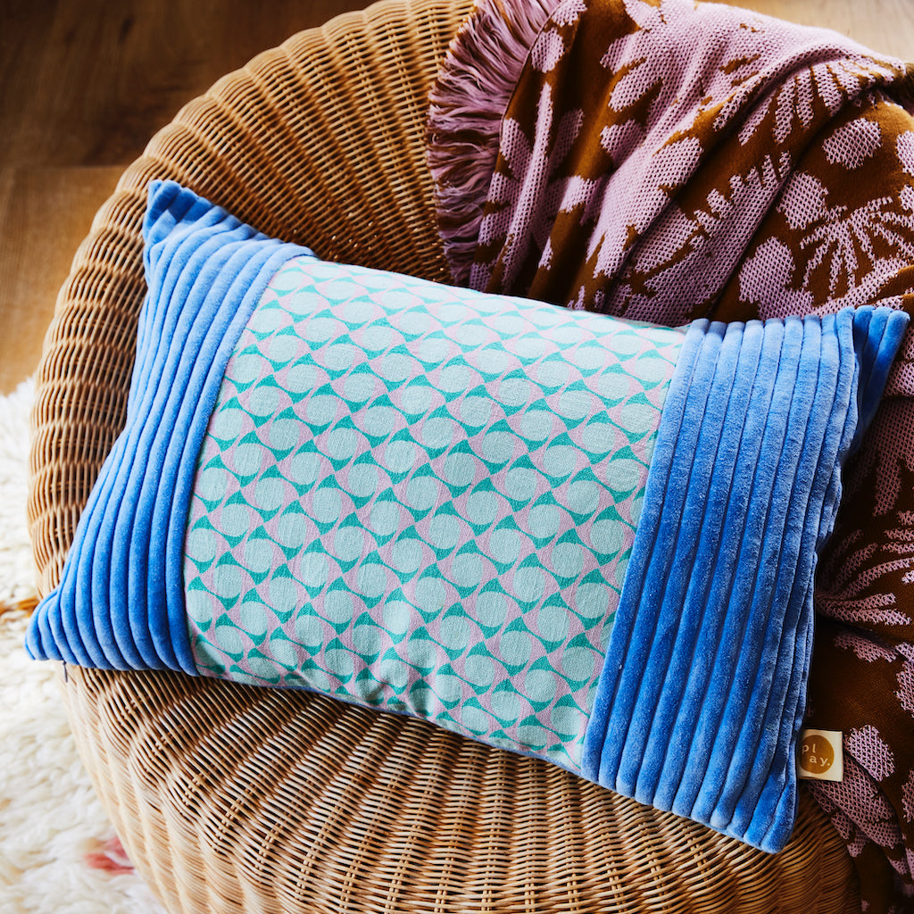 Skidoo Corduroy Cushion. Retro inspired geometric pattern which is panelled by cornflower striped corduroy. Finished with a textured cotton reverse.
