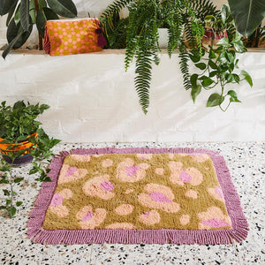 Tanga Leopard Bath Mat in honey, nude and orchid with fringed edges