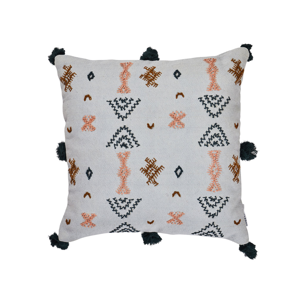 Teres Embroidered Cushion. An aztec inspired pattern with hues inspired by the American desert landscape and styled from traditional folk art. It is finished on a woven cotton cushion with playful embellishments and tassels.