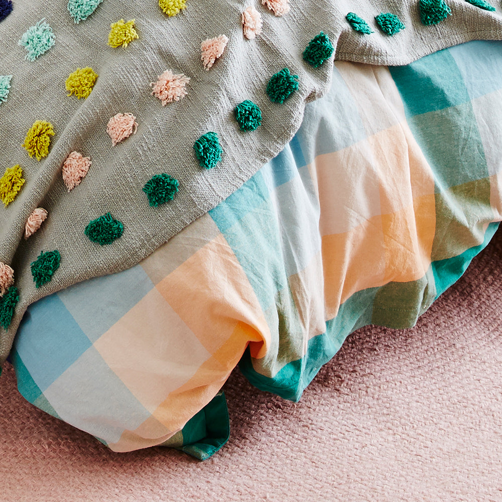 This season's key colours of emerald, turquoise, coral and blush have been woven to create this large scale check quilt cover with a textural hand feel