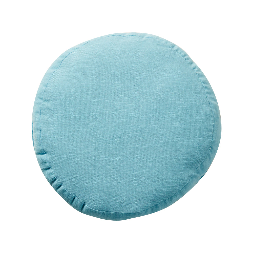 This turquoise textured cotton cushion is the ultimate roundie, pre-filled and with a contrasting coral embroidered edge.
