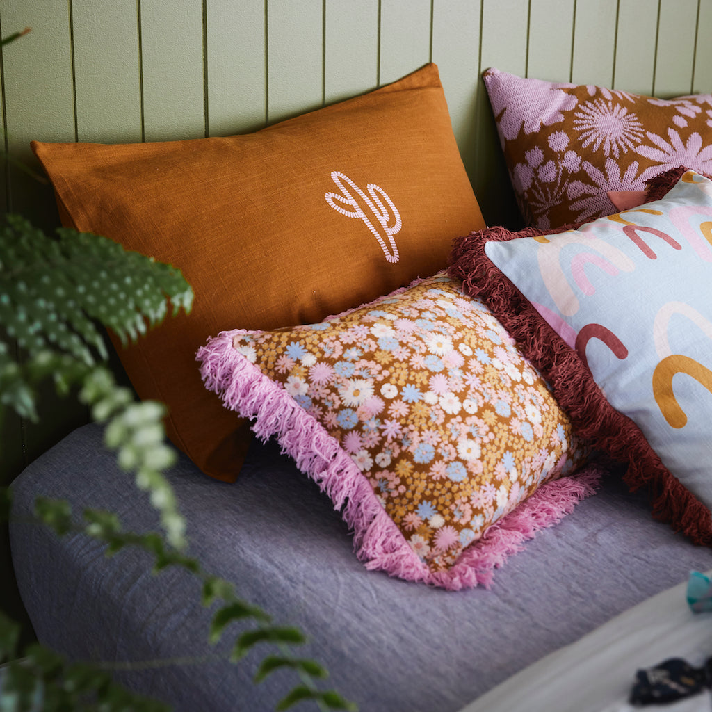 Tule Knit Cushion. Jacquard knit cushion with desert floral print in taffy and tan colour ways.
