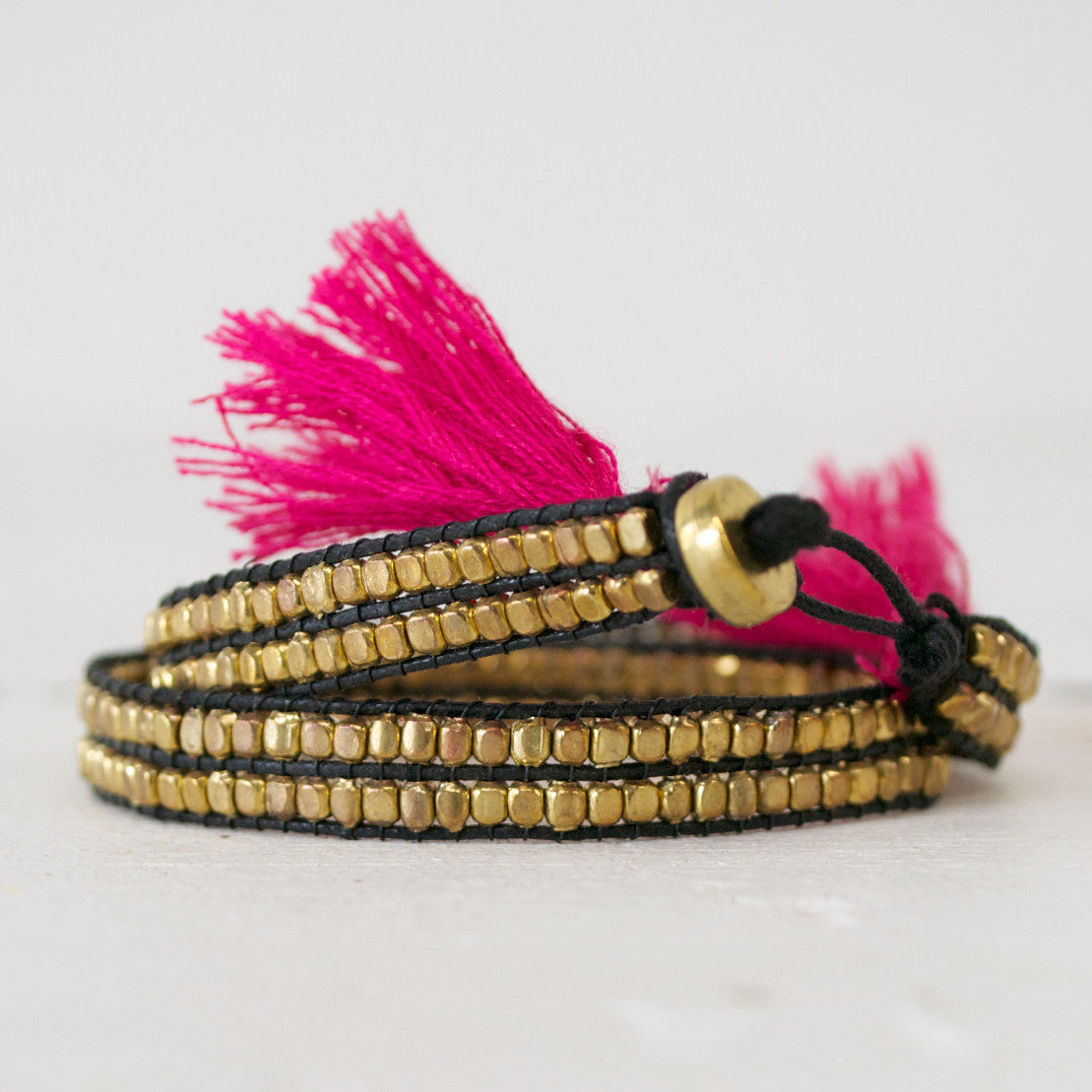 black with magenta tassel