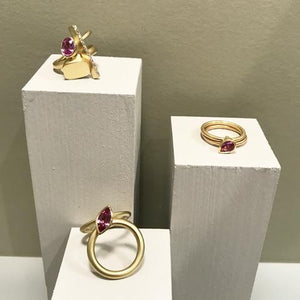 Contemporary engagement rings in gold with pink sapphires