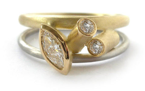 unique, one off, contemporary diamond engagement ring in yellow gold and platinum.