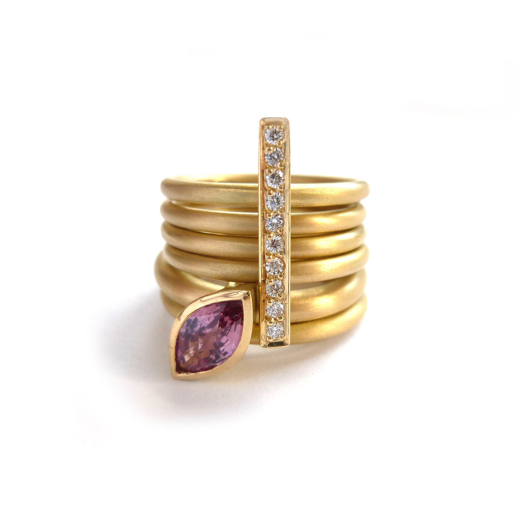 modern gold and diamond stacking ringset with beautiful pink sapphire