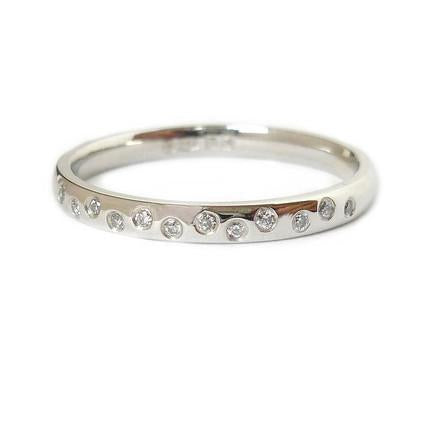 Platinum and diamond engagement, wedding or eternity ring - contemporary and unique.