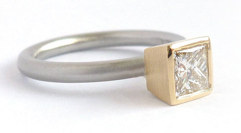 A beautiful, contemporary platinum and 18ct yellow gold engagement ring with diamond.
