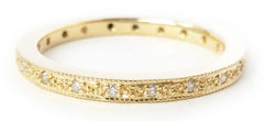Classic eternity ring design in 18ct gold by Sue Lane.