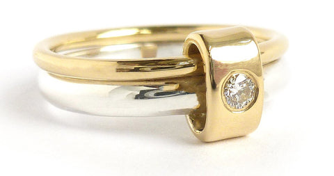 A classic Sue Lane silver and 18ct gold two band engagement ring with a beautiful diamond. Contemporary and unique.