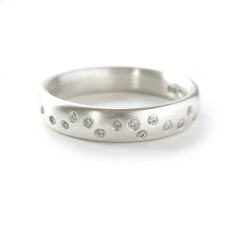 A modern contemporary silver and diamond ring that would make a beautiful wedding ring, unique engagement ring or bespoke eternity ring.