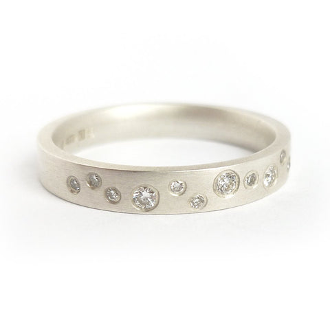 A modern contemporary silver and diamond ring that would make a beautiful wedding ring, unique engagement ring or stack it alongside your own collection of rings.