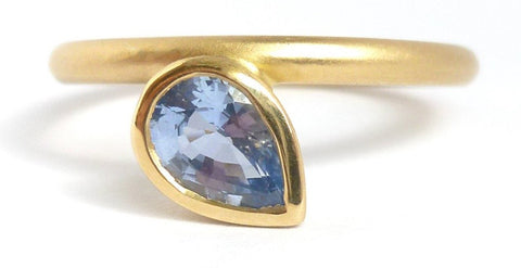 A bespoke cornflower blue sapphire 18ct gold engagement ring. Contemporary and unique.