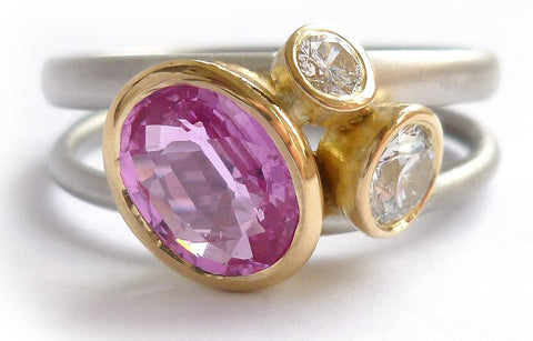 A contemporary alternative engagement, eternity or anniversary ring with stunning pink sapphire.
