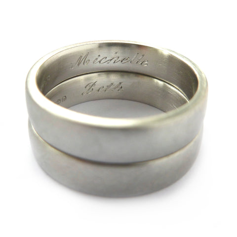 Handmade wedding rings engraved with the couples names