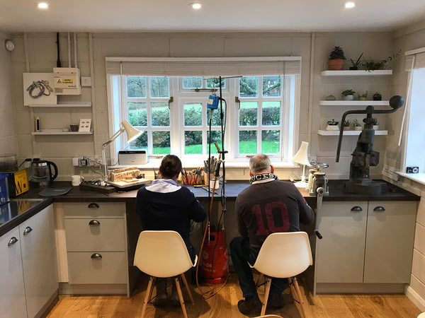 Couple making their own wedding rings in Sue Lane's Herefordshire jewellery making studio.