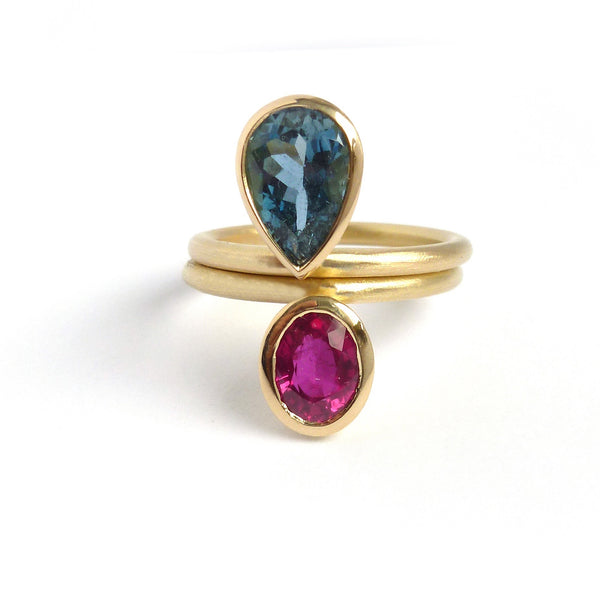 Oval ruby and pear shape aquamarine gold bespoke ring set for a ruby wedding anniversary present handmade by Sue Lane