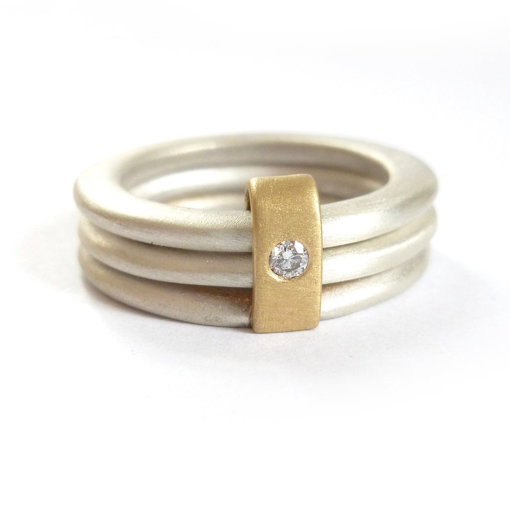 modern three band linked ring with gold and diamond details handmade by Sue Lane