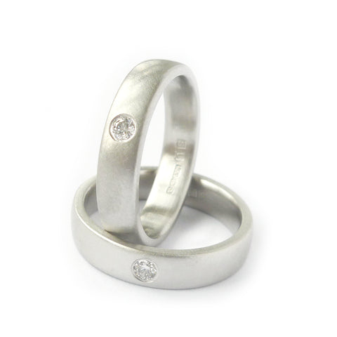Modern platinum and diamond wedding rings made to commission