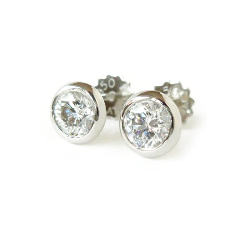 Contemporary platinum and diamond stud earrings by sue lane jewellery, commission, bespoke