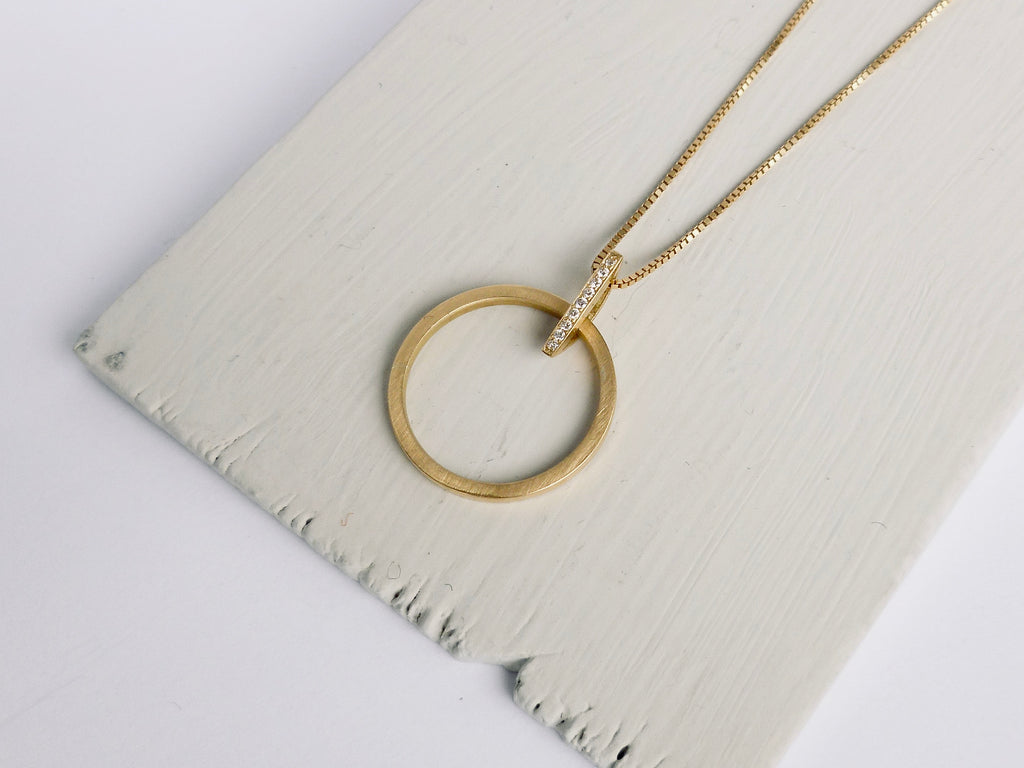 Gold and diamond circle necklace - contemporary jewellery