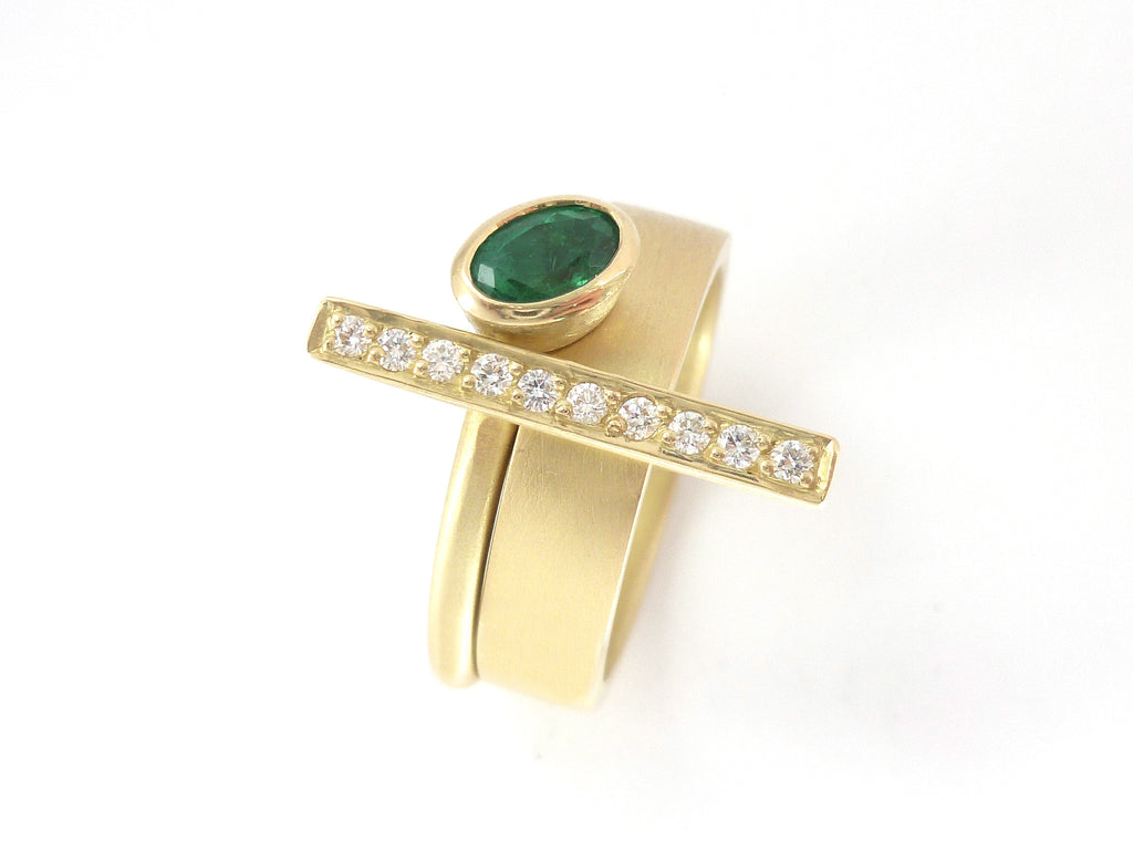 Bespoke emerald and diamond dress ring perfect for a May birthday