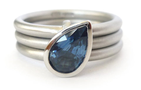 Platinum and cornflower blue sapphire unique, bespoke and unusual alternative wedding or eternity ring.