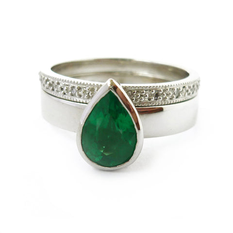 Bespoke commissioned platinum and pear shape emerald and diamond ring set by Sue Lane