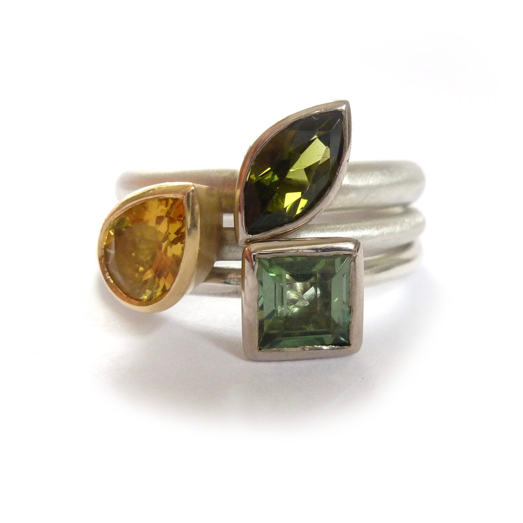 Modern stacking rings in silver and gold with tourmaline and beryl