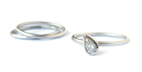 Unusual, unique, bespoke and modern platinum and diamond wedding and engagement ring commission. Handmade by contemporary designer maker Sue Lane Jewellery UK