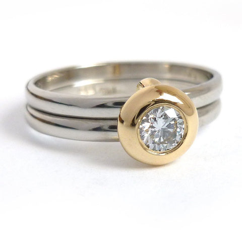 Two band contemporary wedding ring in 18ct white and yellow gold.