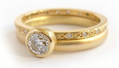 A 18ct gold and diamond two band engagement ring - unusual, unique and bespoke