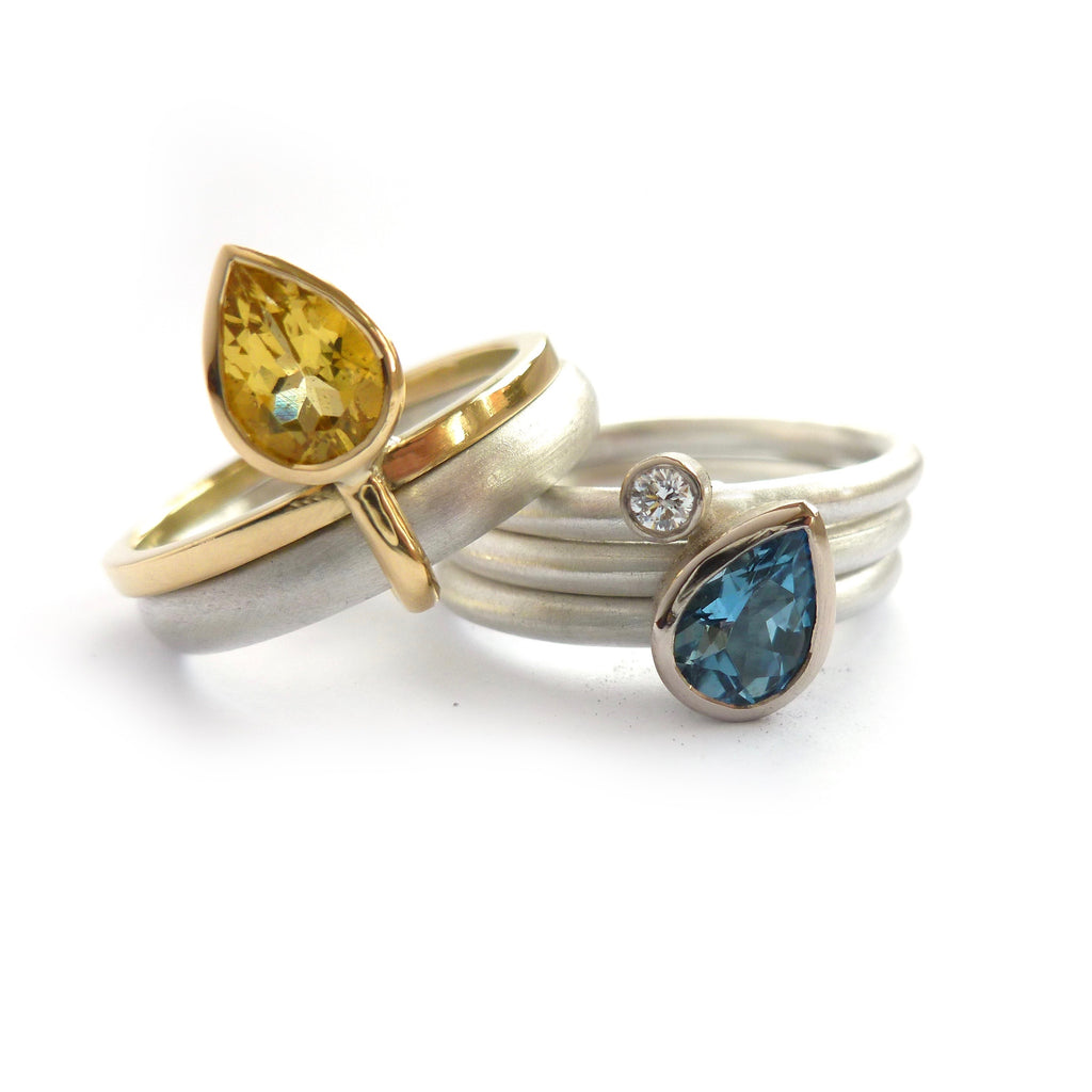 Yellow beryl and aquamarine ringset in silver and gold