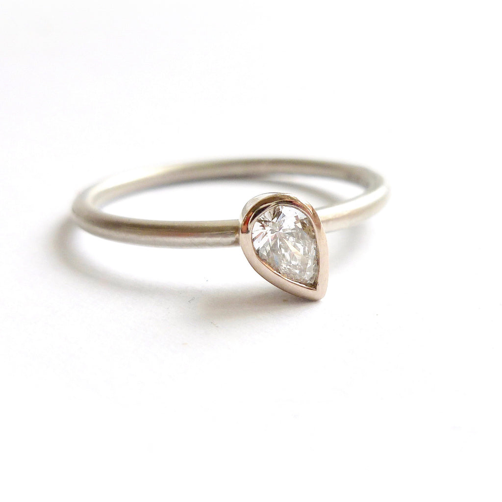 Modern delicate platinum and pear shape diamond engagement ring