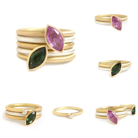 Silver, gold stacking ring set with pink sapphire and green tourmaline with a diamond ring.