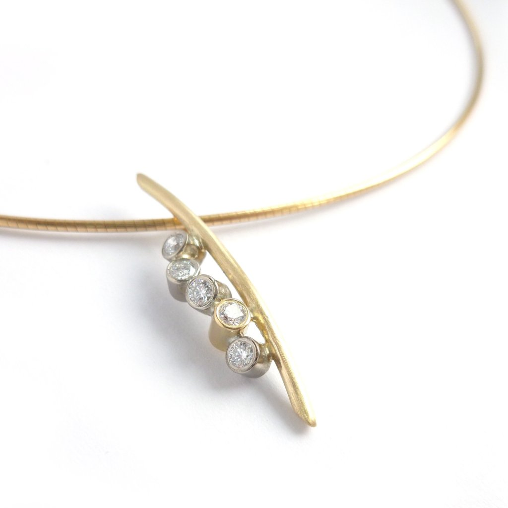 A modern two tone gold and diamond necklace / pendant with a soft necklet