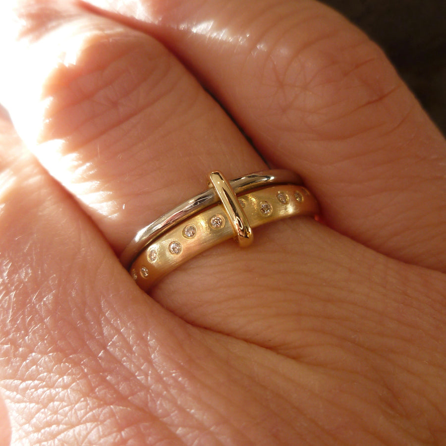 Modern, unique two band ring joined together with diamonds. An alternative eternity or wedding ring. Multi band ring or interlocking ring, sometimes called double band ring too.