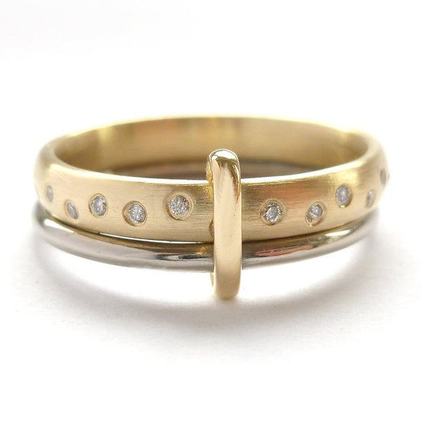 modern and unique two band ring joined together with diamonds. A alternative eternity or wedding ring. Handmade in UK