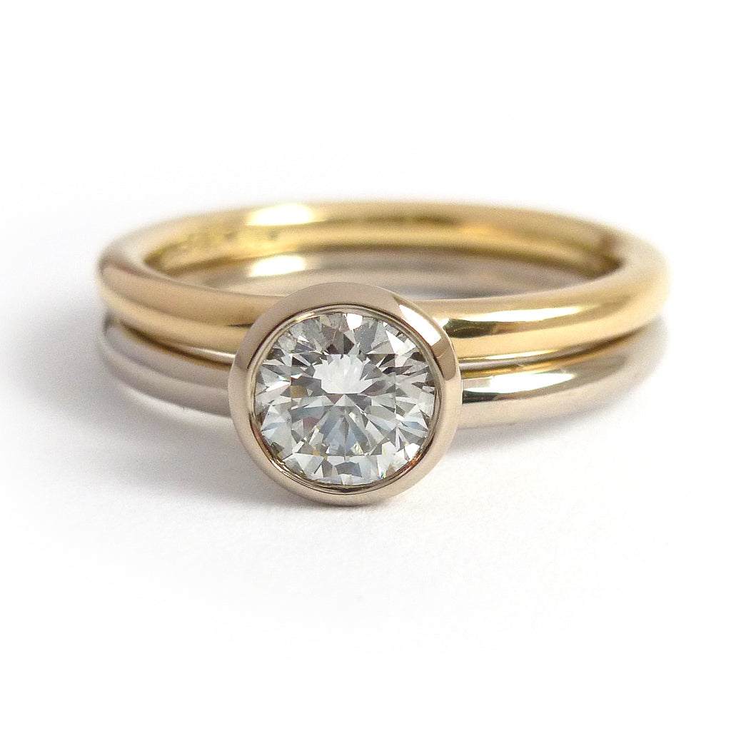Modern, contemporary two band ring in 18ct white and yellow gold with large diamond. Multi band ring or interlocking ring, sometimes called double band ring too.